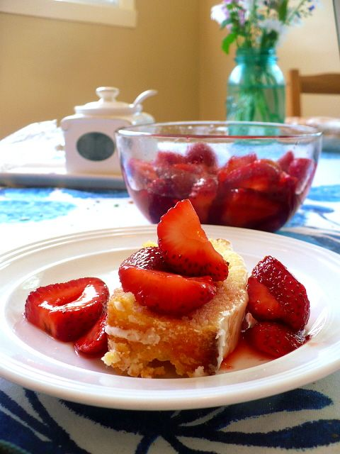 Lemon Pound Cake ... with strawberries soaked in sugar and a bit of cointreau or grand mariner ... YUM!