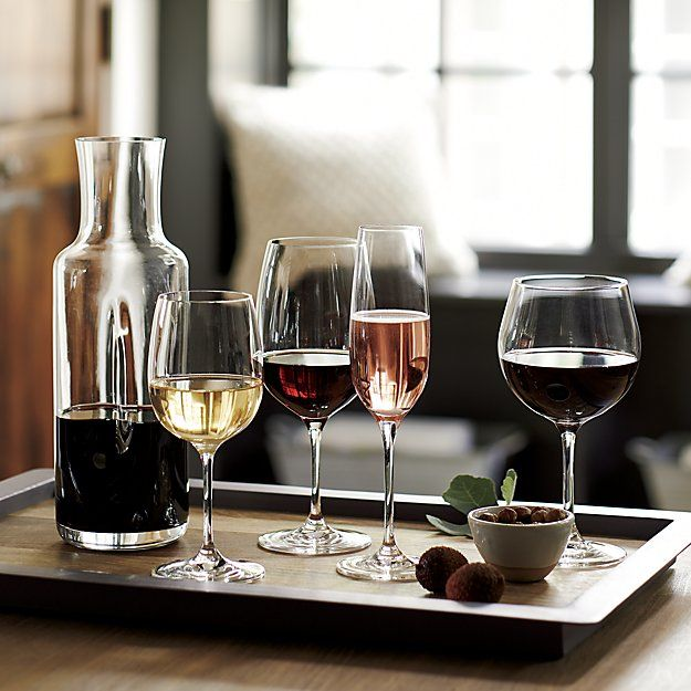 Shop Pinch Modern Carafe.  Subtly pinched contour makes an impression on slim, modern carafe, ergonomically shaped for an effortless, perfect pour of wine, water, juice and other cold beverages.