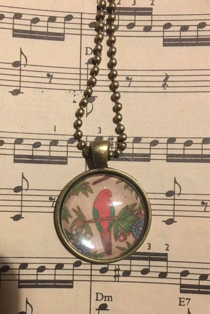 A personal favourite from my Etsy shop https://www.etsy.com/au/listing/536897782/parrots-art-pendant-and-chain-necklace