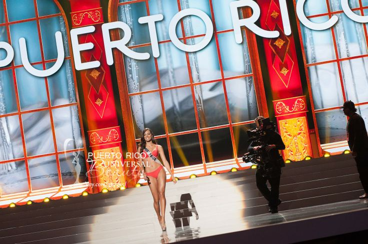 Monic Perez, Miss Universe Puerto Rico 2013, competes in the swimsuit competition in her 2014 YAMAMAY FOR MISS UNIVERSE swimwear collection featuring footwear by Chinese Laundry during the Preliminary Competition at Crocus City Hall on November 5, 2013.