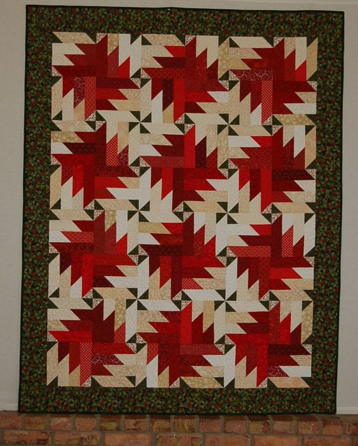 """Christmas Quilt for Sale, """"Peppermint Twist"""" is a red and green Handmade Patchwork Quilt/Lap Quilt/Christmas Décor/Quilt for Sale by MyCottonandThread on Etsy"""