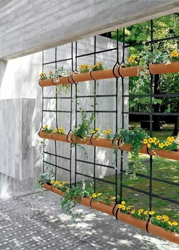 """Attractive rain gutter planters as """"wall"""" between neighbors on the deck."""