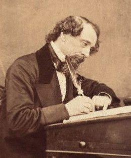 "Dickens working at his desk in 1858, two years before ""Great Expectations"" was published in ""All The Year Round"""