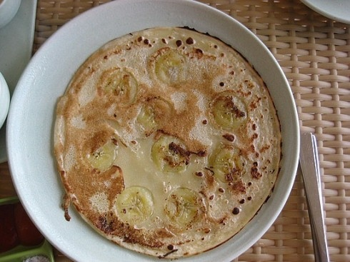 Balinese Banana Pancakes-serve with fresh coconut and honey. The best breakfast I have ever had!