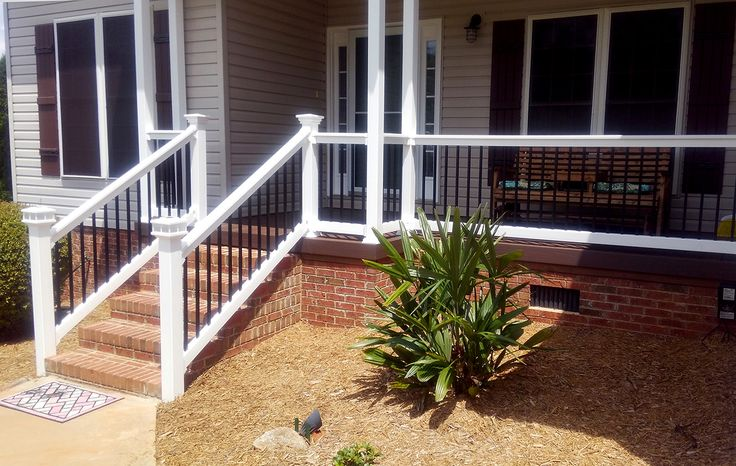 Birmingham vinyl railing with aluminum spindles is the perfect style for any porch or patio.