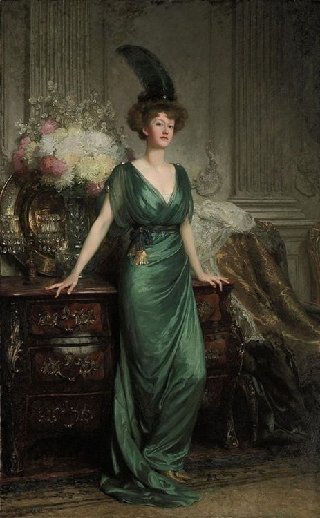Portrait of the Hon. Mrs Ernest Guinness, standing, full-length, wearing an emerald dress and feather (1912) by Sir Francis Bernard Dicksee (1853-1928).