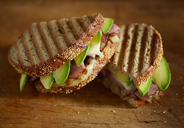 Thin sliced pastrami, grilled onions, Monterey Jack cheese and fresh California Avocado served with whole grain mustard on rye bread.