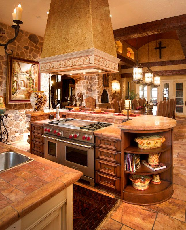 Cooktop Island with additional storage and round-end shelves by Mullet Cabinet in Millersburg, Ohio