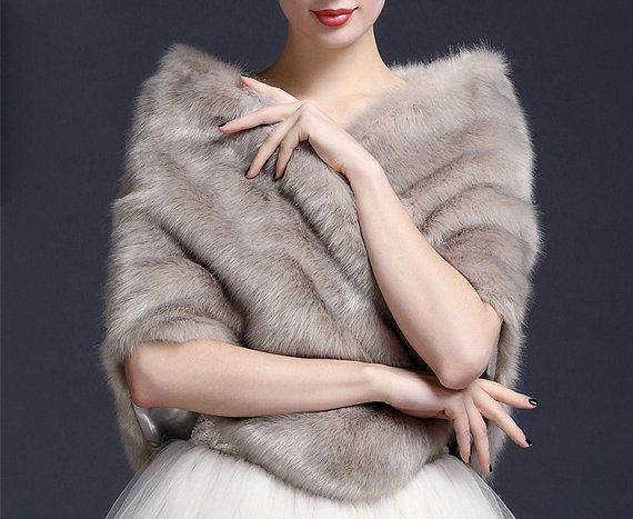 This pretty fur cape will make you look gorgeous and warm in winter wedding! Our faux fur shawl is the perfect wedding accessory in cold weather for a fall or winter wedding. Theres a hook in the front to keep the cape stay. Contact us for more patterns :)  ♥ Approximate size  Width: 30-50cm Length: 140cm
