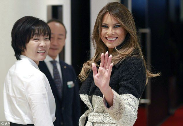 U.S. first lady Melania Trump waves to photographer as she and her Japanese counterpart Akie Abe, left, visit Mikimoto Ginza Main Store, Japan's pearl jewelry maker