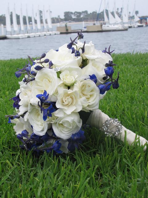 I'm thikin white and blue bouquet's for the bridesmaids and the same for me but with a hint of red!