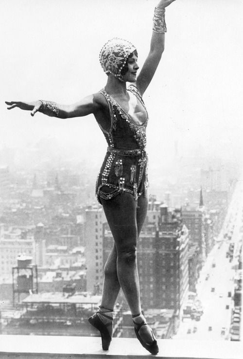 Lina Basquette, well known dancer and musical comedy star, rehearsing new steps for an upcoming production  on a ledge of the roof of the Hotel Commodore, twenty-eight stories above 42nd Street, New York c. 1926.