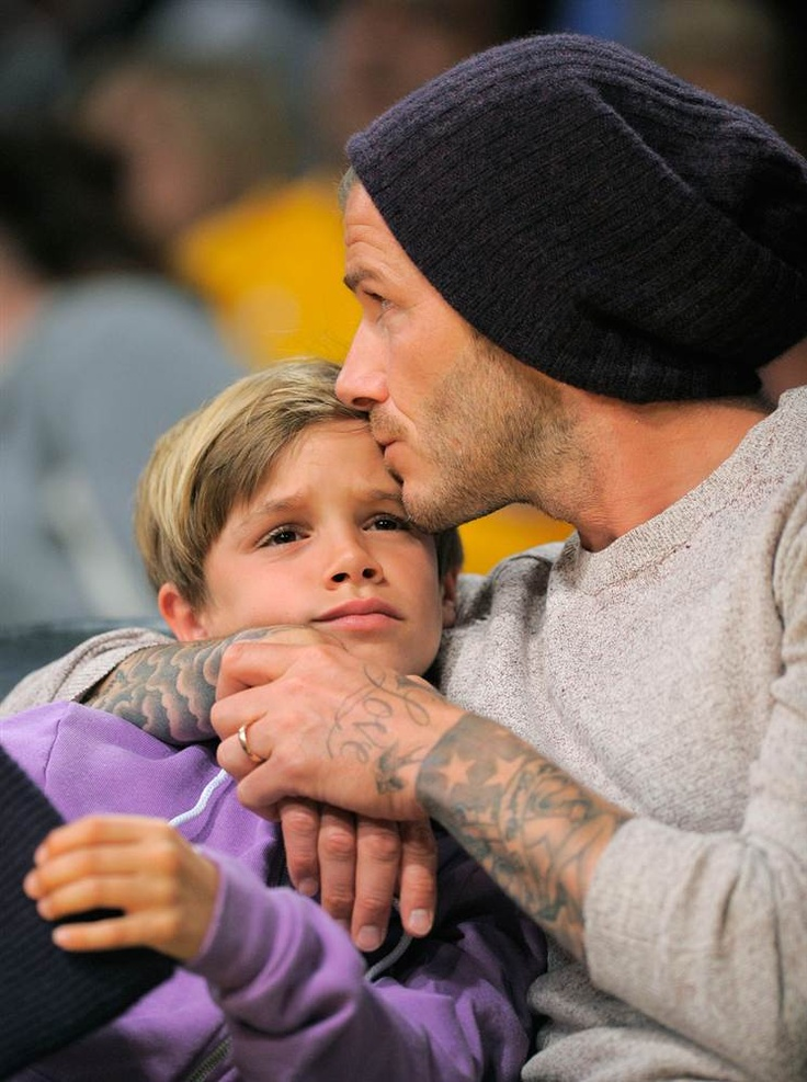 I apparently can't get enough today.  David Beckham & Romeo Beckham (so sweet when a daddy kisses his children)