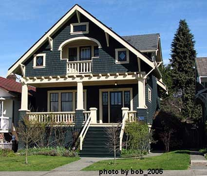 Craftsman bungalow with interesting trellis detail.  Love that nook on the 2nd floor...