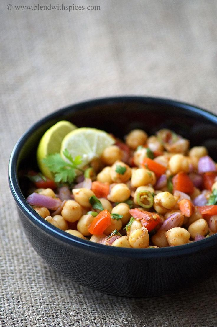 Chana Chaat - A spicy, tangy & healthy Indian street food made from chickpeas - An easy snack recipe! #indianrecipes #vegan #snackrecipes