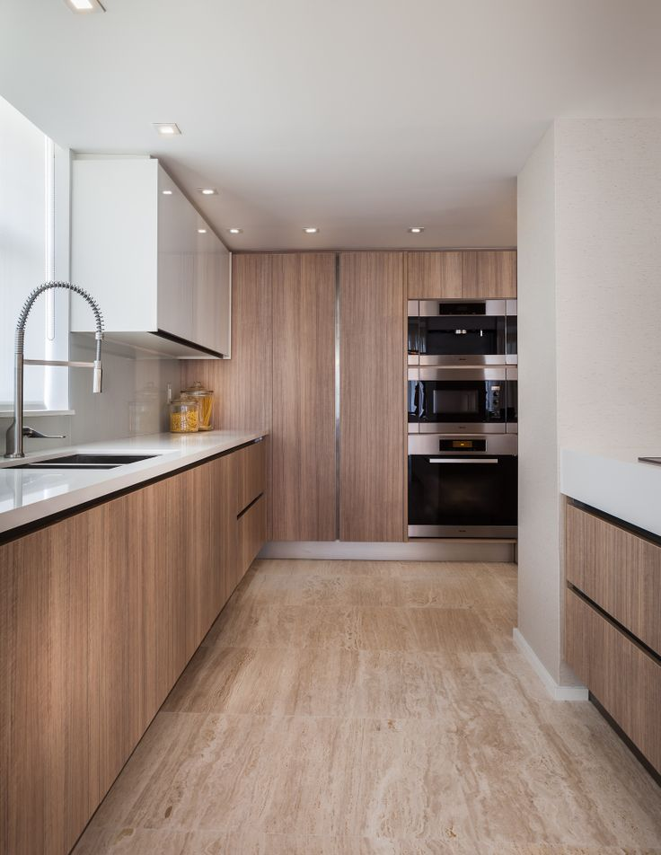 Project by 2id interiors - South Beach    Contemporary Elegant Cozy Beach kitchen. Custom made Kitchen by Ornare. Beautiful tall kitchen faucet. Appliances by Miele.