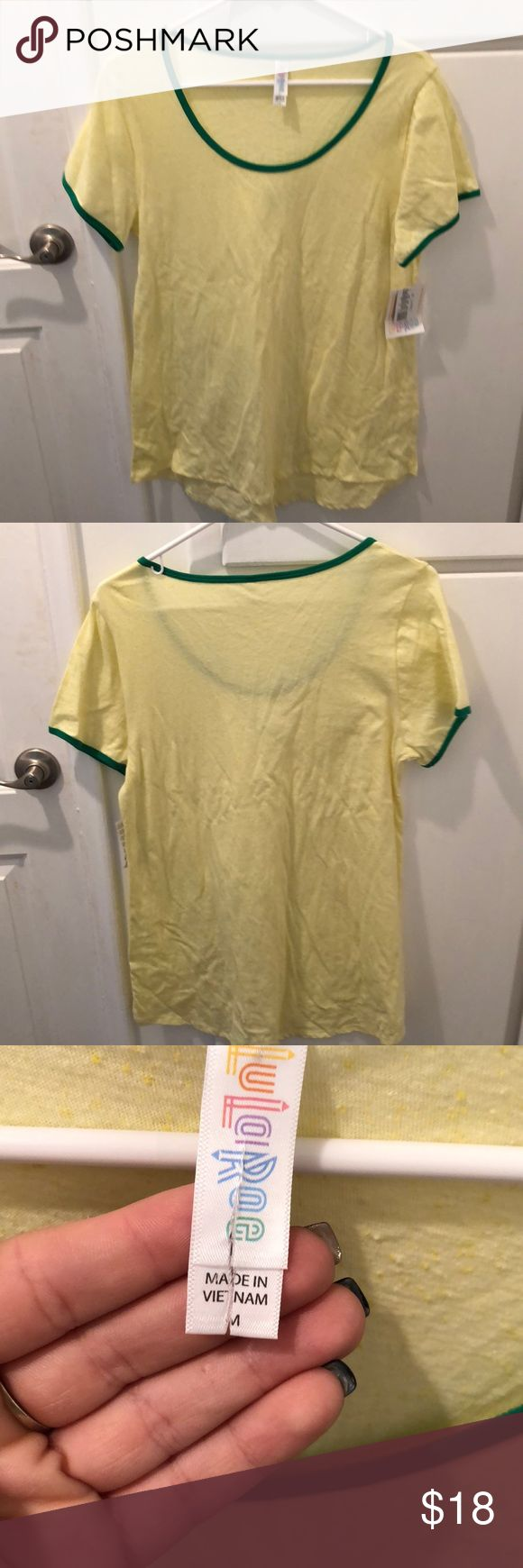 Lularoe classic T New with tags . Size medium . Lularoe tags connected to shirt is a bit split in half only flaw . LuLaRoe Tops Tees - Short Sleeve