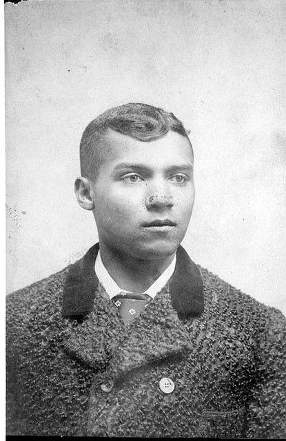African American Man    African American man seated, head and shoulders, in a buttoned overcoat. c.1890