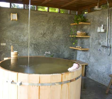 This is an outdoor bath but it would be great indoors too ... I love Japanese baths and this one looks nice and deep; perfect for soaking.