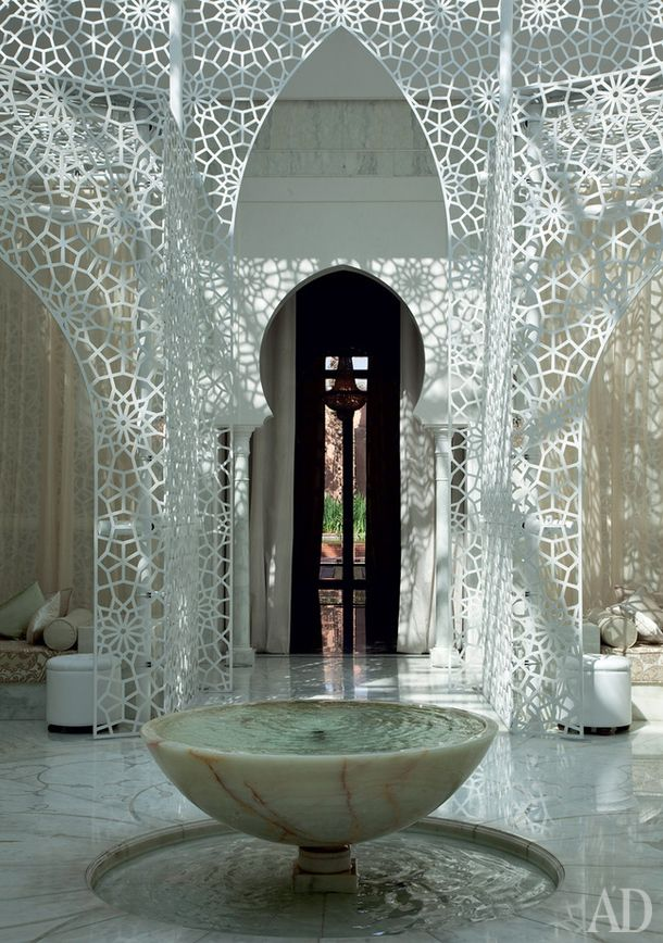spa occupies a separate riad. In the centre of the main hall - a traditional fountain in the form of a bowl, placed on the perimeter of the low sofas, Royal Mansour, Marrakech