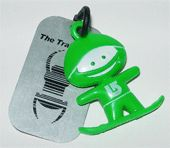 Travel Bug: Example of a Travel Bug tag with plastic toy attached.