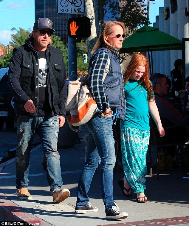 Helen Hunt enjoys a casual outing in Brentwood with longtime love Matthew Carnahan and their daughter Makena
