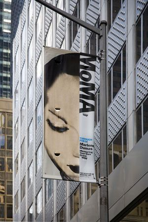 Street banner highlighting the current Dumas retrospective.