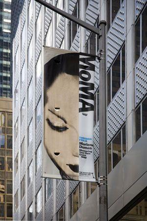 Street banner highlighting the current Dumas retrospective.