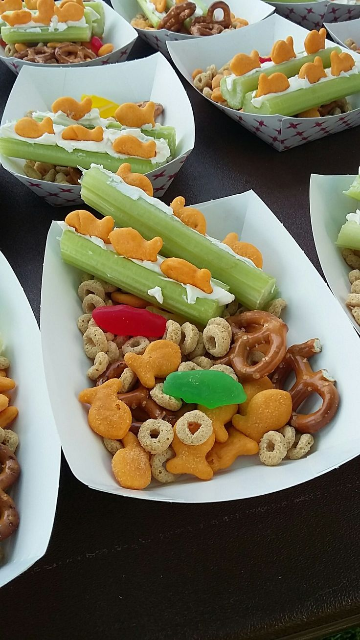 Celery sticks with cream cheese and gold fish toppers, home made chex mix. I used cherrios,  gold gish, pretzels and Swedish fish.