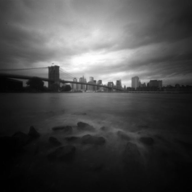 Pinhole Photo 5  I liked this picture because it makes the city look different because there is only a little bit of light, and that is what characterizes pinhole photos.