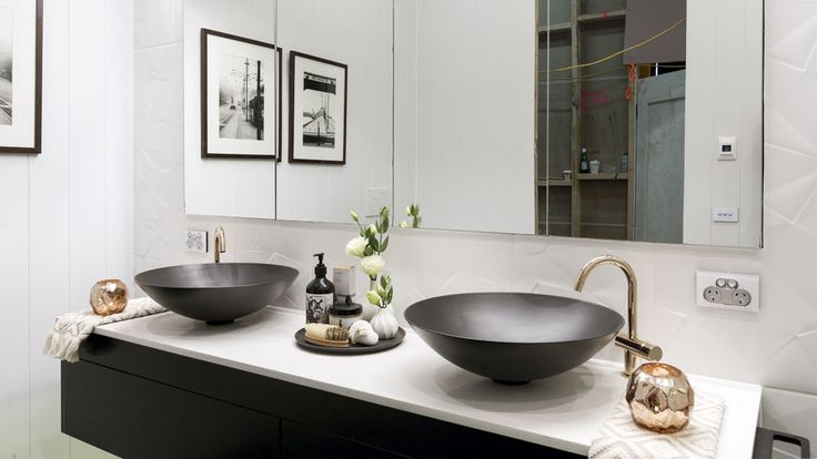 MAIN BATHROOM by Karlie & Will featuring a Rifco Acqua vanity 1800w in black satin with a Caesarstone top in White Shimmer. It also features a Rifco Overlay mirror cabinet fully recessed.