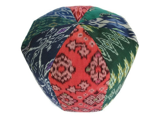 Coral, blue, and green authentic Ikat Pouf from ginette1223's Etsy shop.