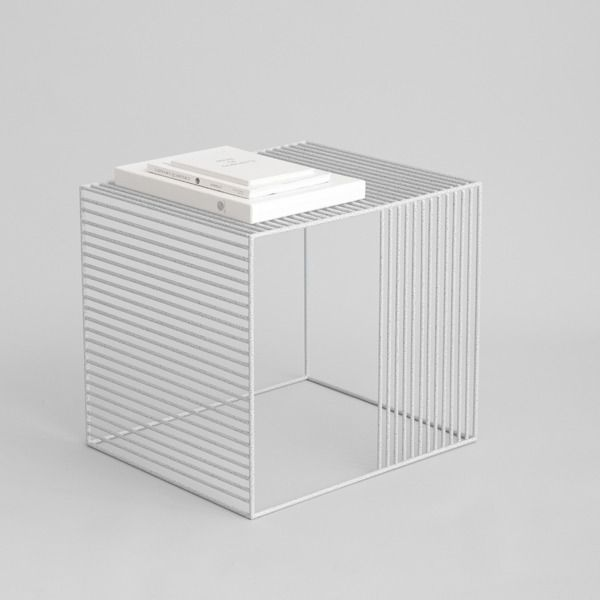 The Wire Side Table by Jamie Iacoli and Brian McAllister, heavily relies on geometry and it is the play of lines that I particularly like. The side table is made out of powder coated, stainless steel and is actually more decorative than practical I imagine.