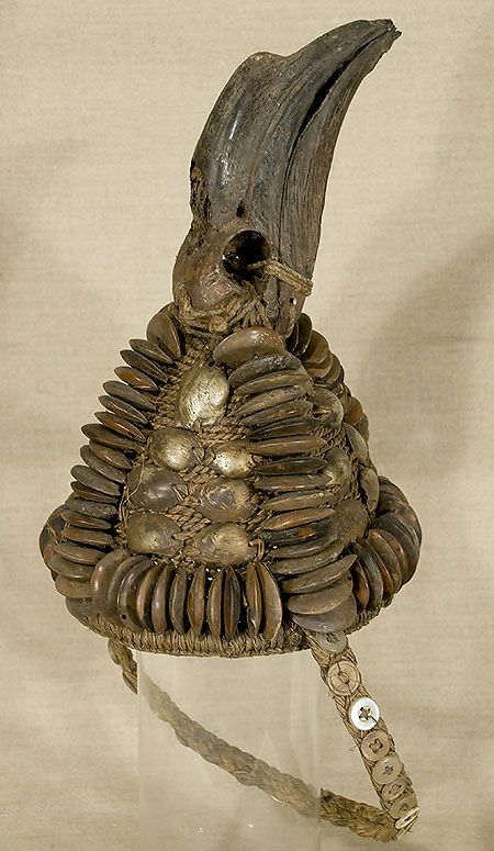 Africa | Lega Bwami Ceremonial Hat,  The Congo | Vegetable fiber with shells, seed pods, buttons and hornbill. Early to mid-20th century.