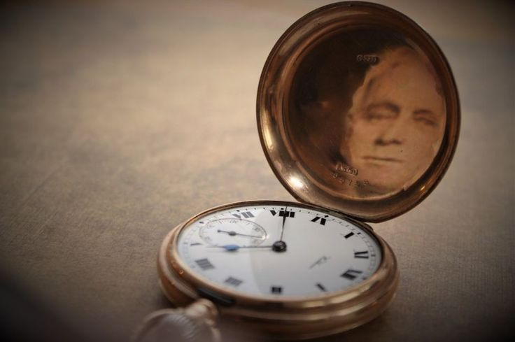 A pocket watch with a man's face in it