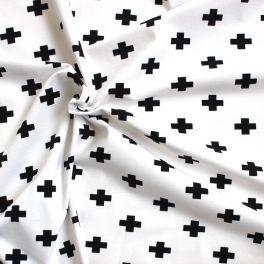Tissu jersey croix noires fond blanc