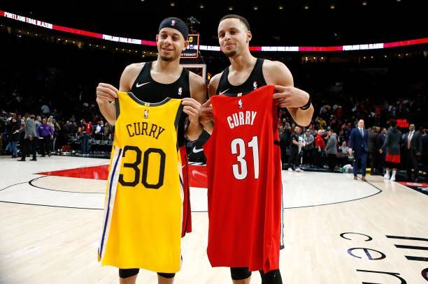 newest 9b142 9a376 Stephen Curry of the Golden State Warriors trades jerseys ...