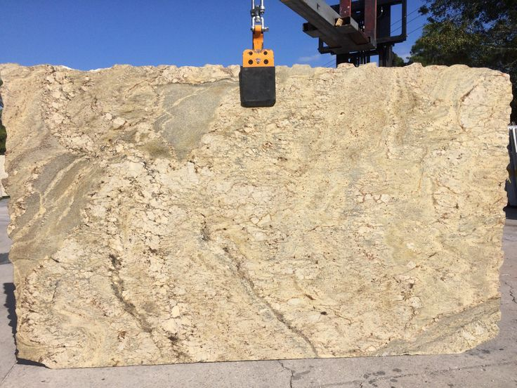#TyphoonBordeaux granite golden background with beige and brown blend of creamy tone in slab. Typhoon Bordeaux a perfect #granitecountertops for light #kitchencabinet and #kitchenisland.