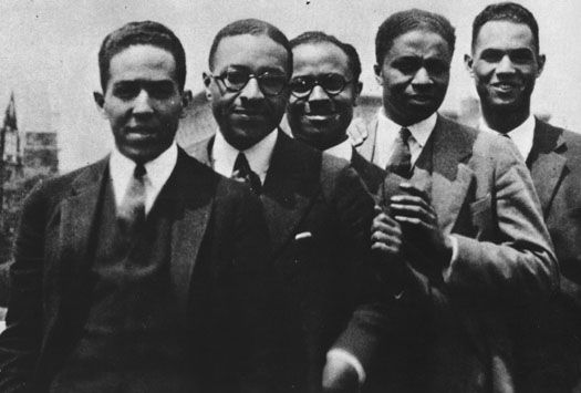From the Schomburg Center online exhibition, Harlem 1900-1940: An African American Community. This photo depicts young Black writers and intellectuals gathered at the Harlem Home of Regina Andrews and Ethel Ray Nance. The group, photographed at a party held for Langston Hughes, includes (from left to right): Poet Langston Hughes, sociologist Charles Spurgeon Johnson, historian E. Franklin Frazier, doctor and author Rudolph Fisher, and legislator Hubert Delaney. This photo is from the collection: African Americans, Brown Universe, Franklin Frazier, Black Experiments, Rudolph Fisher, Ivy League, African American History, Black History, Langston Hughes