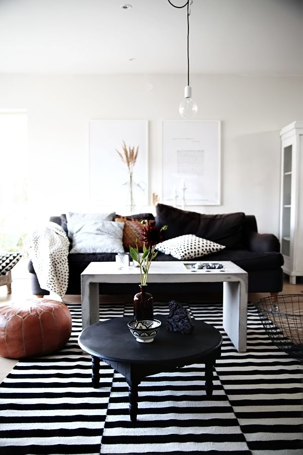 The much used Ikea carpet still makes a room look great. Love the splashes of brown to soften up the b/w look.