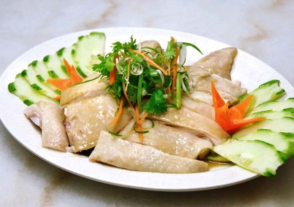 What makes a good Hainanese Chicken? It must be 'kut' (slippery juicy tenderness) and 'phang' (nice fragrant chicken brothy essence of garlic and spring onion and coriander) and this flavour then gets accentuated by the ginger, chilli, garlic and dark soy condiment that you choose to bathe it in.