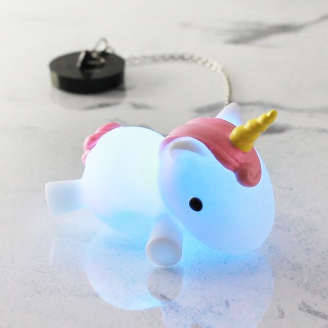 Wallow in the soothing mythical glow of the Colour Changing Unicorn Bath Plug This belly-flopping fantasy beast lights up the moment it's stomach hits the