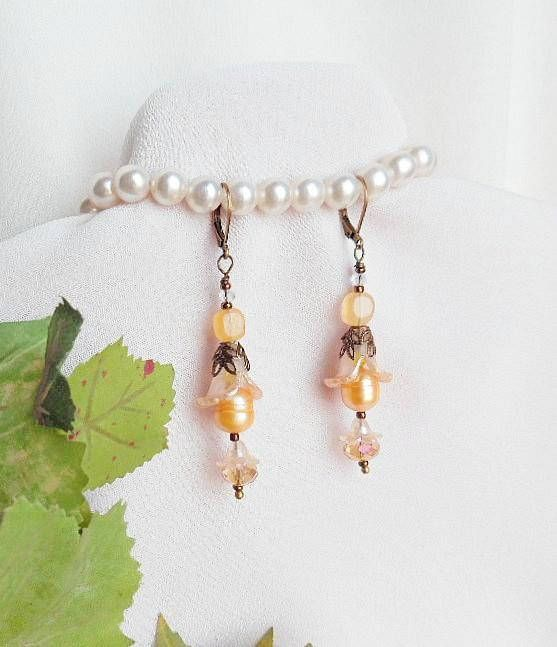 PIN NOW, CHECK OUT LATER!    #elegancebydorianne #victorianjewelry #victorianstyle #victorian #earrings #vintagefashion #etsyjewelry #etsyshop #etsyjewelryshop #giftsforher  VPEG1 Delightful, Petit Victorian Style Earrings! Lovely golden potato pearls, bloom from the center of transparent lilies, hand painted with delicate