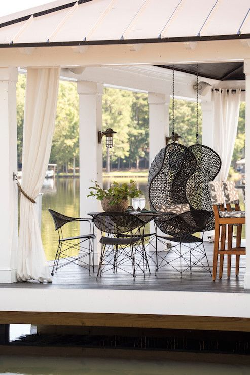 Boat Dock Transformed Into Lounge Features A Pair Of Side By Side Woven  Hanging Chairs Finished