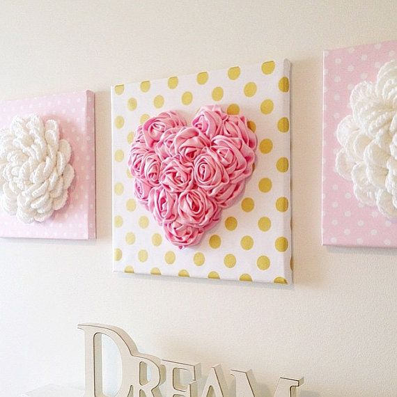 Make your walls pop with our gorgeous 3D Heart Wall hangings! Perfect for a baby nursery or girls bedroom. Decor that will impress wherever you choose to use it.  Product Details: ~ Satin Heart is approx. 8 in width ~ Satin Heart is securely hand sewn to fabric wrapped canvas ~ Fabric is 100% Cotton ~ Size of canvas is 12 x 12  Our unique wall hanging designs are available in a beautiful array of colours and fabrics.  Customized options available!  Contact us about which flower or heart…