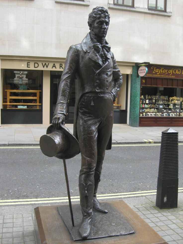 Beau Brummell, was the arbiter of men's fashion in Regency England and a friend of the Prince Regent, the future King George IV. He established the mode of men wearing understated, but fitted, tailored clothes including dark suits and full-length trousers, adorned with an elaborately knotted cravat. (wikipedia)