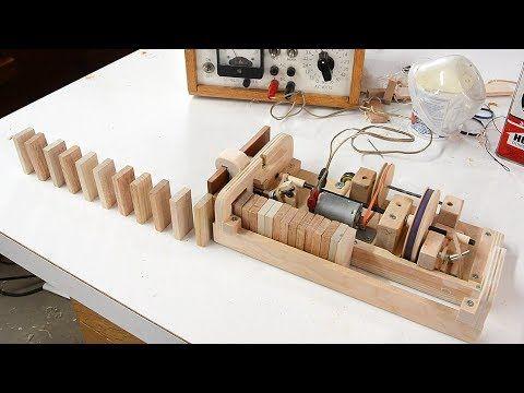 Wooden domino row building machine - YouTube