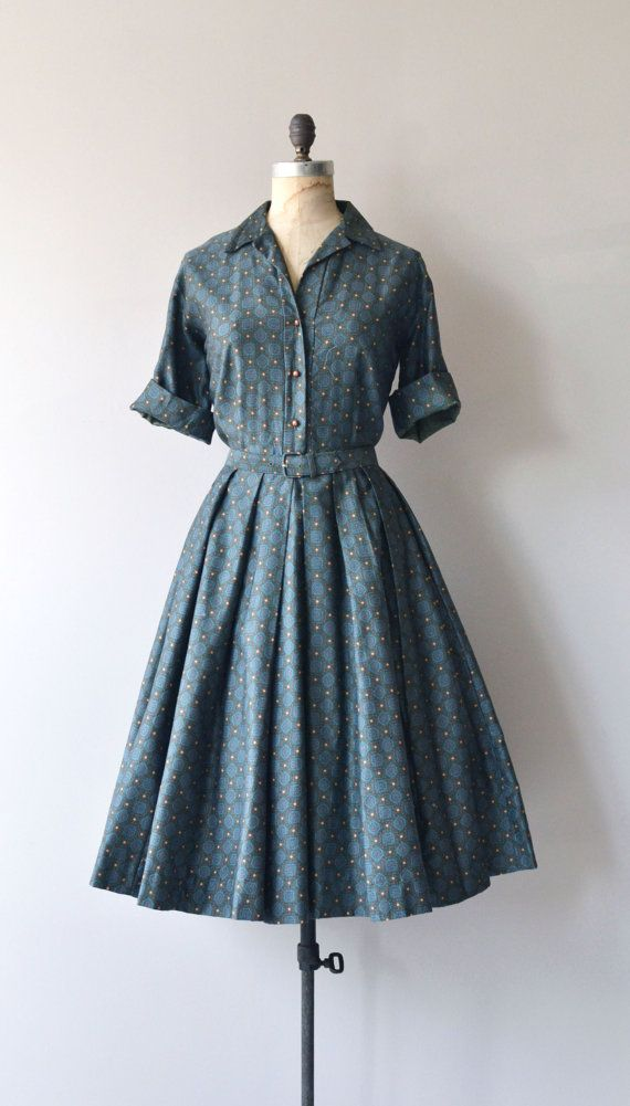 Vintage 1950s super soft cotton shirtwaist style dress in dark moody green with tiny mandala print, open collar, cuffed sleeves, spherical copper metal buttons, fitted waist, matching belt and full skirt. --- M E A S U R E M E N T S --- fits like: medium shoulder: 17 bust: 36-40 waist: 28 hip: free length: 44 brand/maker: Marjorie Montgomery condition: excellent to ensure a good fit, please read the sizing guide: http://www.etsy.com/shop/DearGolden/policy ✩ mo...