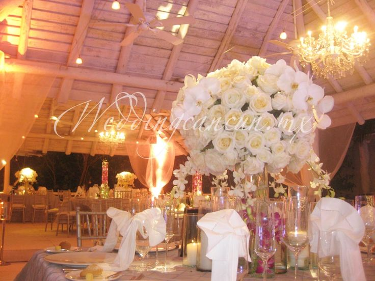#deluxe #centerpiece #white phaleanopsis orchids and roses #weddingcancun by #latinasia