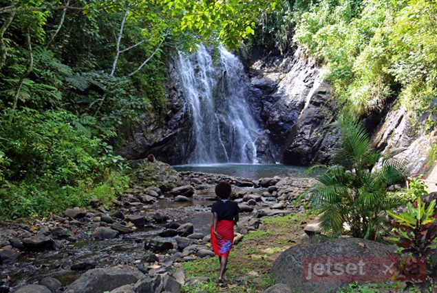 Hiking to the waterfall for a swim from Vuadomo Village